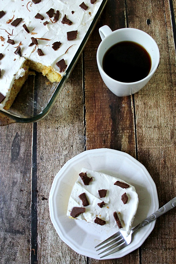 Tiramisu Poke Cake, It is delicious, creamy from the whipped cream and cream cheese layer, sweet from the yellow cake layer soaked with sweetened coffee.
