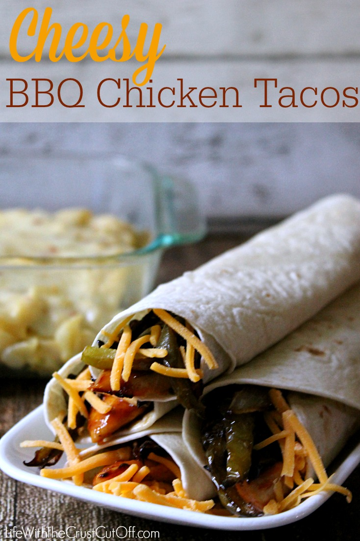 The chicken, the onions and peppers all get piled on soft tortillas ...